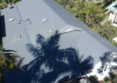 AFTER PHOTO Residential roof spraying/painting in Avalon